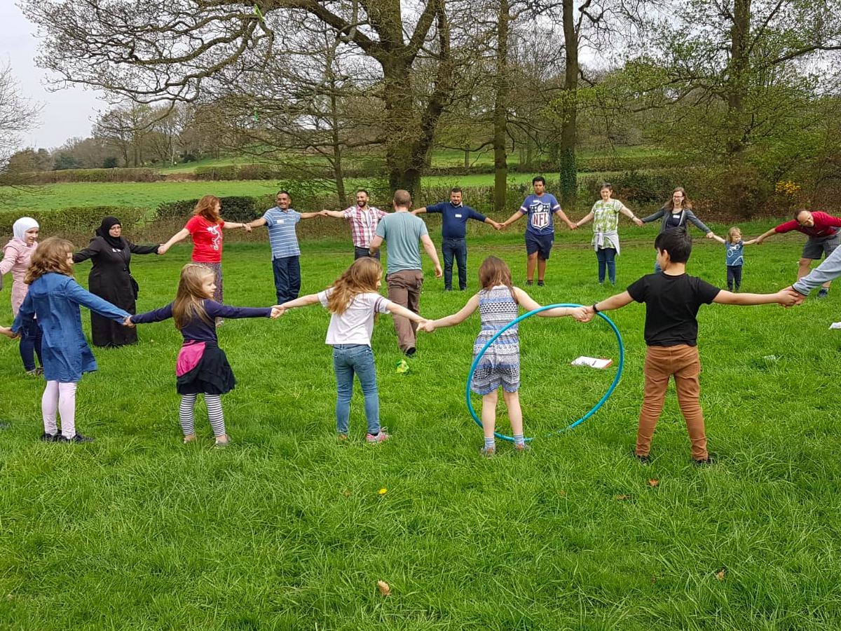group of children playing in a circle