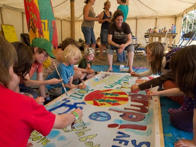 About Woodcraft folk - children painting a sign in a tent