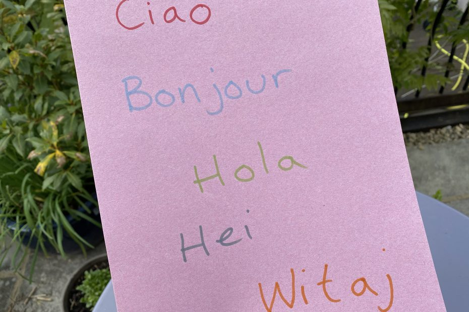 Ciao, Bonjour, Hola, Hei & Witaj written on a sheet of paper