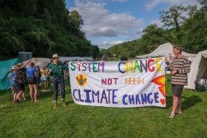 system change not climate change banner