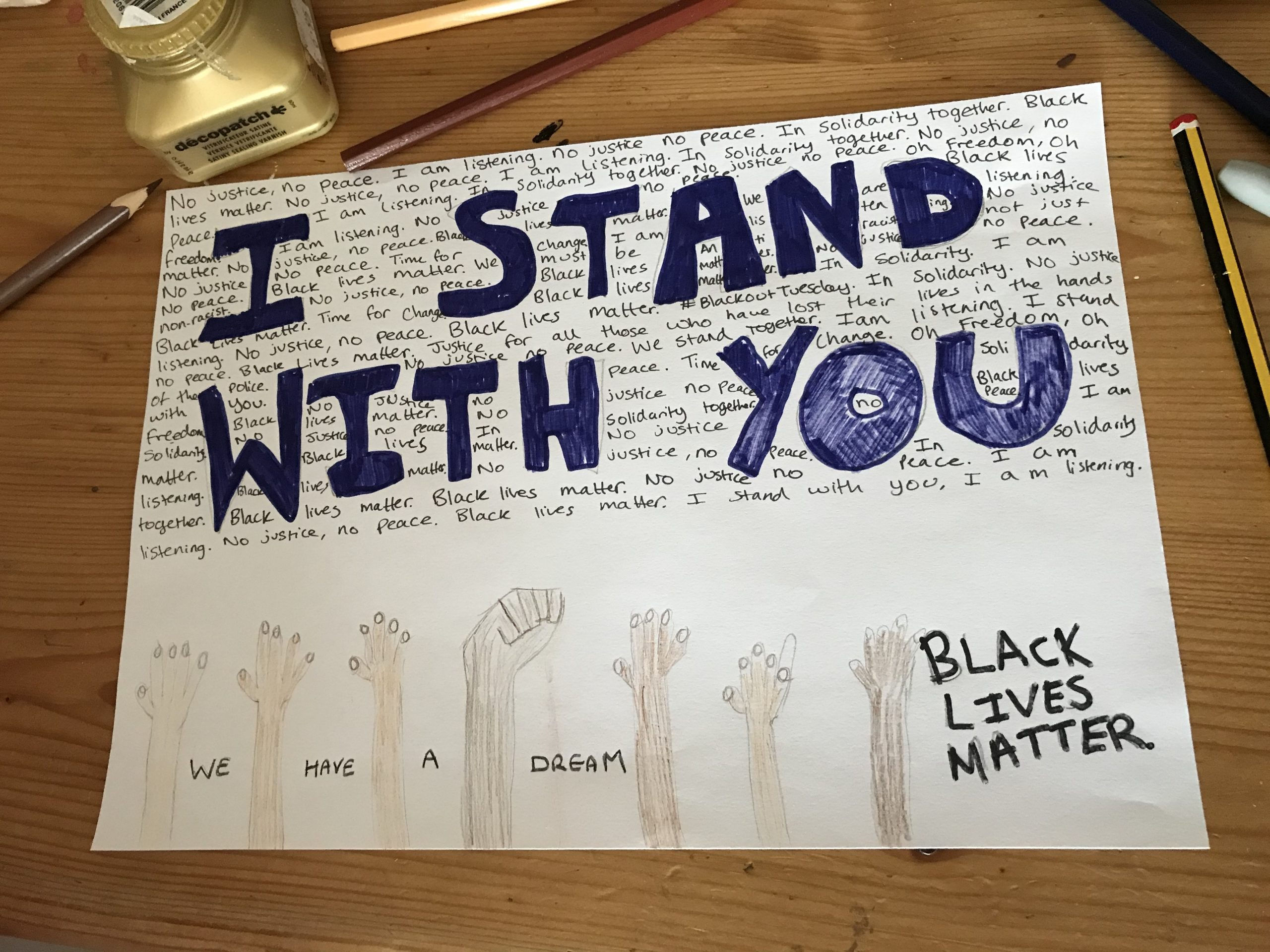 homemade poster with raised fists and the slogan 'I stand with you'
