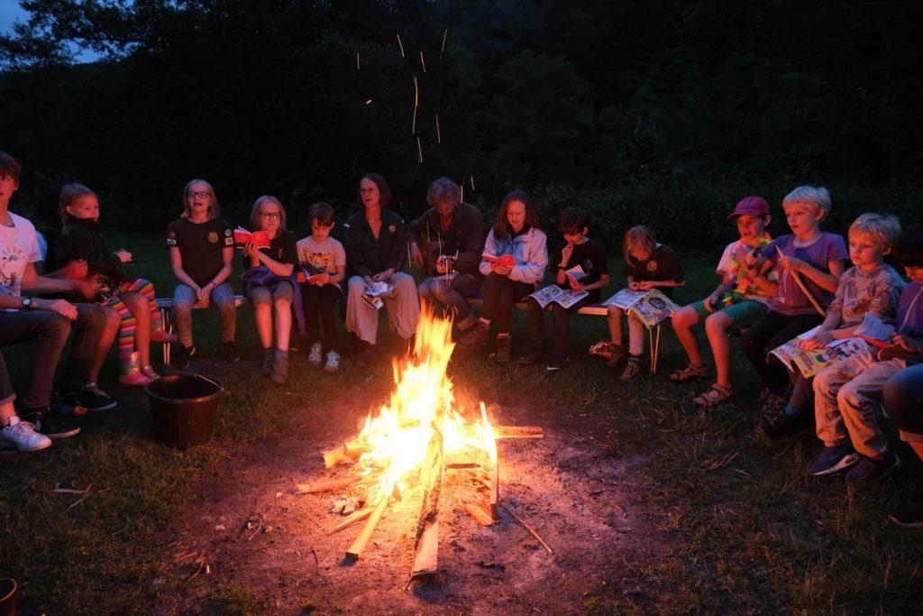 children around a campfire