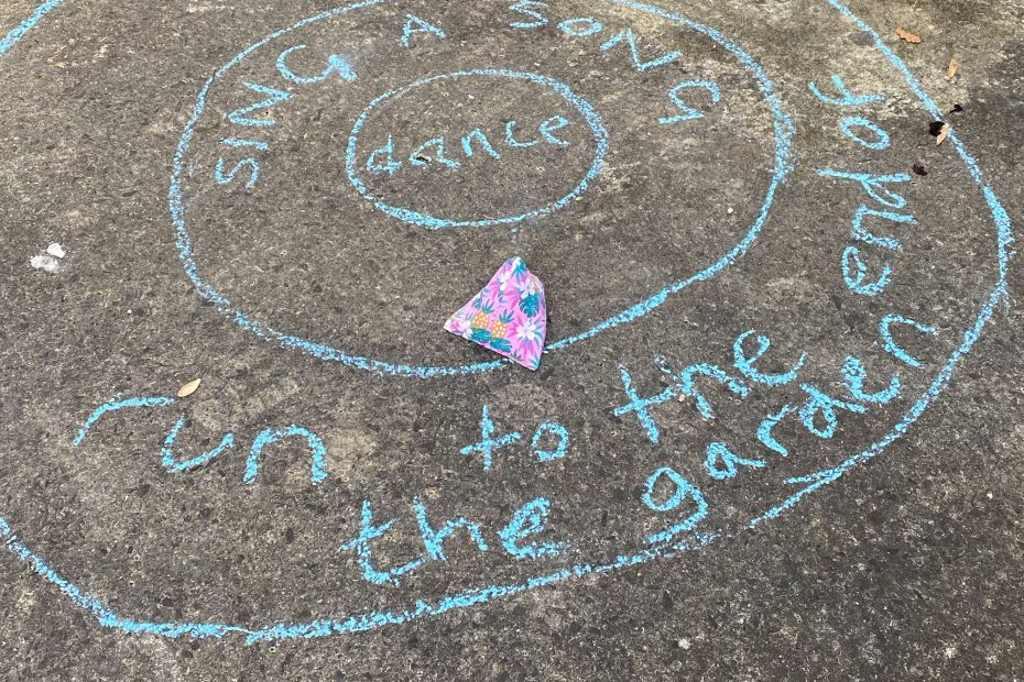 make a bean bag game - the beanbag has been thrown in a circle with the instruction sing a song in it