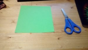 Square piece of green paper